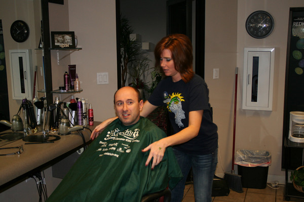 Officer sitting in barber chair