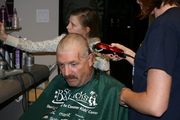 Officer getting head shaved