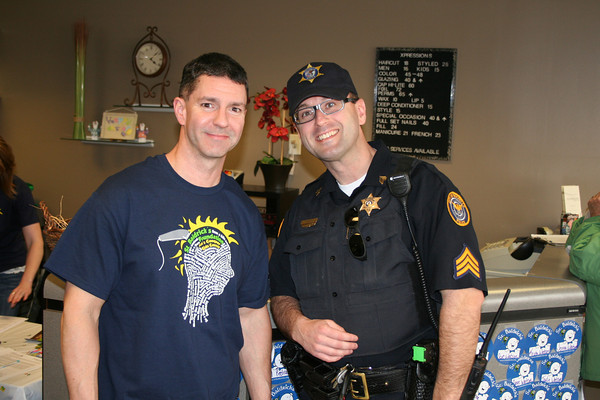 Two officers standing in salon